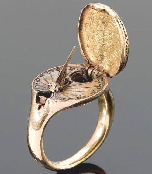 1570, relógio de sol e bússola de ouro.