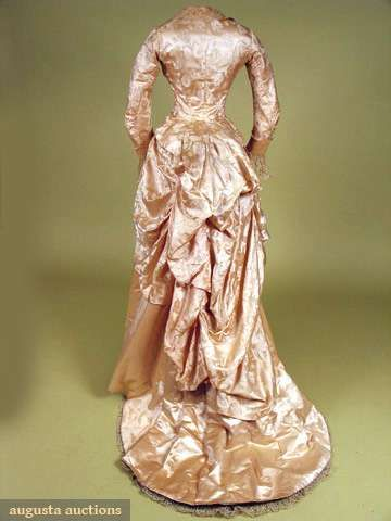 SHELL PINK SILK RECEPTION GOWN, 1880s 1-piece trained gown, bodice attached at…