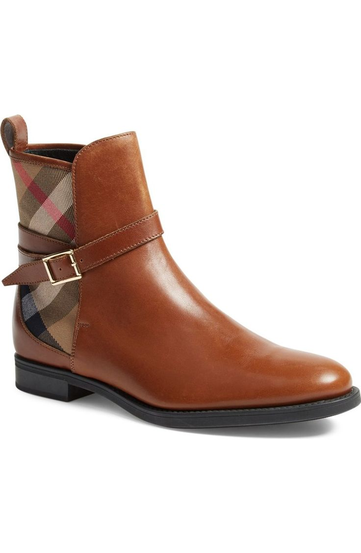 Adoring this Burberry boot detailed with the signature check print and equestrian-inspired straps.