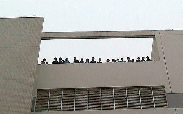 50 Chinese workers at Foxconn, threatened to commit suicide by leaping from their factory roof in protest at their working conditions