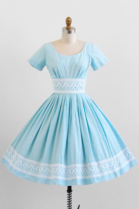 vintage 1950s sky blue embroidered day dress. Why can't they make dresses like this anymore. Just the way they always have a ruffle or palette in just the right spot