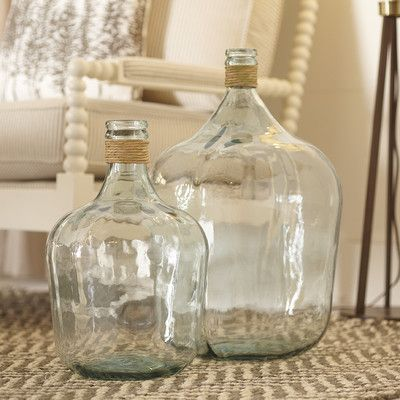Jugs made from recycled glass would make a beautiful centerpiece or accent to a space. | $69