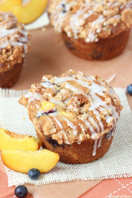Blueberry Peach Cobbler Muffins - perfect for the season! This recipe makes jumbo sized muffins full of juicy peaches and ripe blueberries!