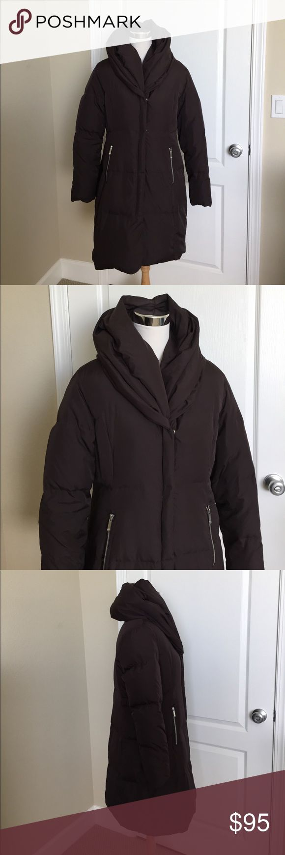 MICHAEL KORS COAT A warm winter puffer coat by Michael Kors that is in great condition. The only wear I know of is the right hand side pocket came undone on the inside. You can see it on the last picture. Easy fix with simple sewing. The color of the coat is brown. Michael Kors Jackets & Coats Puffers