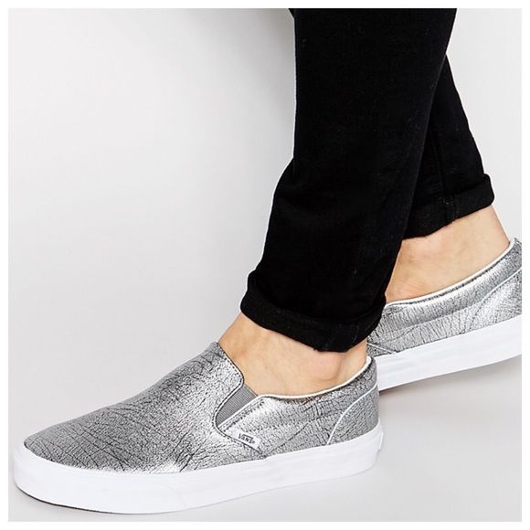 NWOT Vans Metallic silver slip ons NWOT Vans Metallic silver slip ons.  Brand new without tags and no shoebox. Men's size 8/Women's size 9.5. First pic is a stock photo. 2nd, 3rd and 4th are the actual shoes.  There are minor scruffs on the side of the shoes.  Never been worn.  Price is firm.  No trades. Vans Shoes