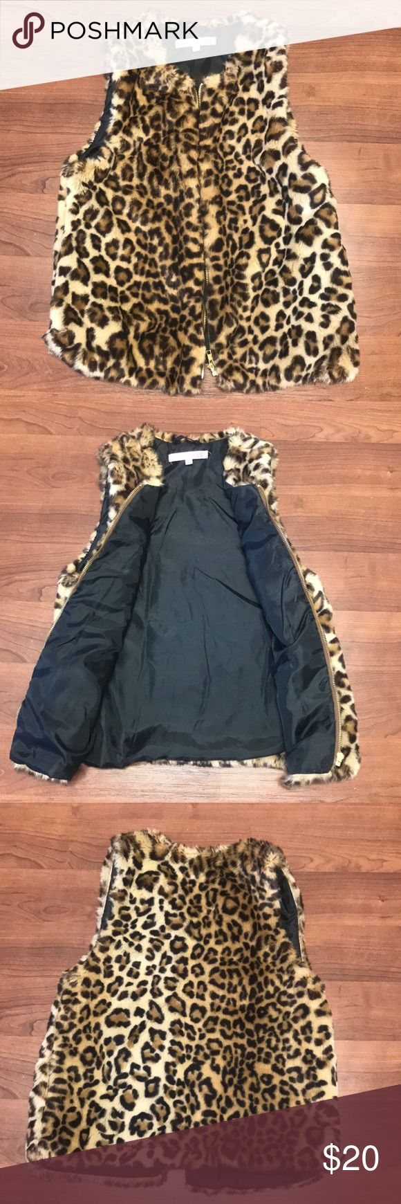 Faux Fur Leopard Vest Size Small- says size 6-7 on tag but fits size small  Has a couple dry spots on fur (shown in photos) but not noticeable at all  Zipper front  Super warm Pockets on side Jackets & Coats Vests