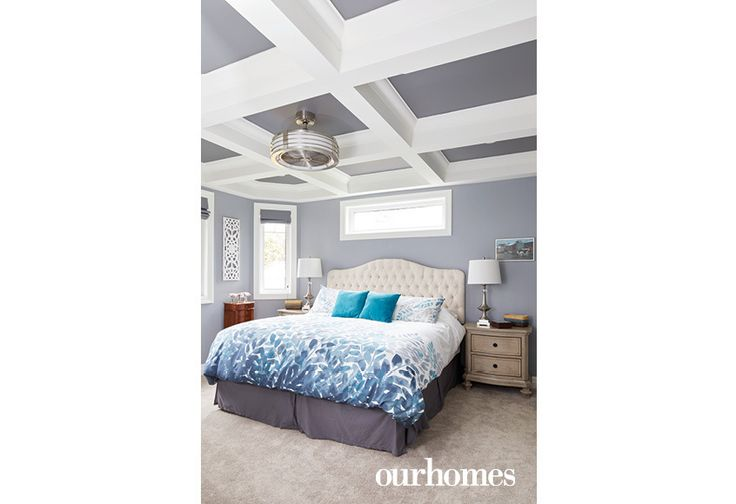 """The master bedroom boasts a coffered waffle ceiling and pocket door entry to the en suite shower and walk-through closet.    See more of this home in """"She Loved this Chandelier and Built a House to Suit It"""" from OUR HOMES Wellington County Orangeville Caledon, Summer 2017: http://www.ourhomes.ca/articles/build/article/she-loved-this-chandelier-and-built-a-house-to-suit-it"""