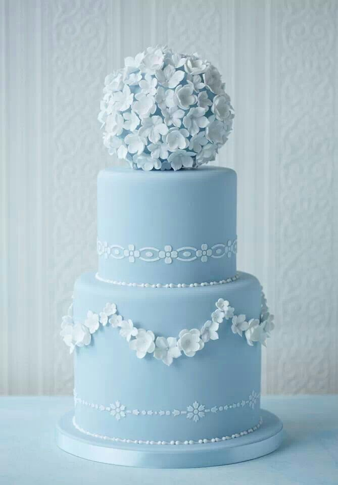 Wedgewood blue wedding cake with sugar flower pomander on top.
