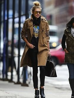 Essential fall outfit.  Love the concert tee, black cigarette pants and camel trench coat.