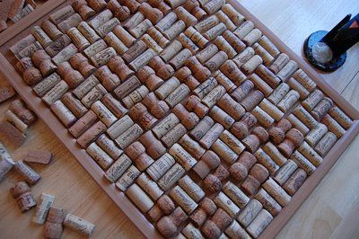 Uses for wine corks! Cork board made with corks! Cut them in half so you don't have to use as many.