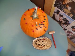 A fine motor activity of hammering golf tees into a pumpkin. In preschool children begin to learn to write and to write they must have good fine motor skills.