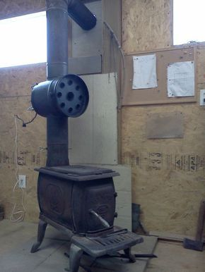 DIY Wood Stove Head Exchanger. Can also incorporate a water heating system using the remaining heat from the chimney!