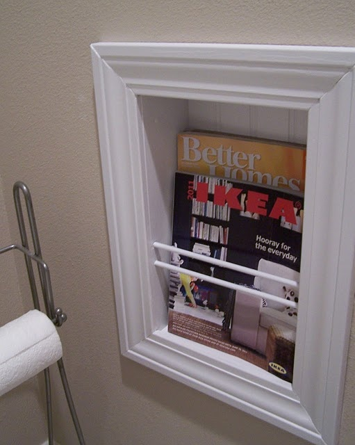 built-in book/magazine rack, traditionally for the bathroom but could work in small spaces beside a bed