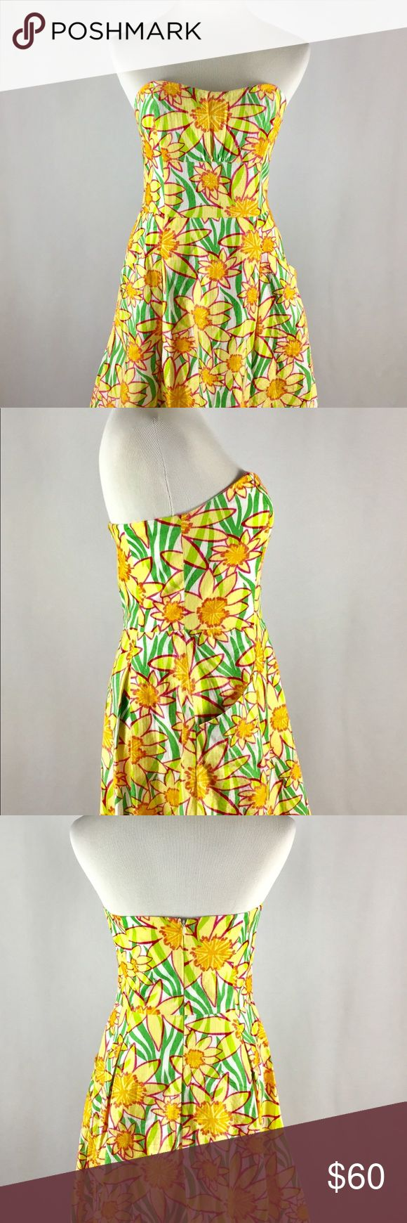 Preowned Lilly Pulitzer Strapless Sundress Size 6 GUC Yellow Green Pink Strapless Sundress. Gently worn shows minor snags as seen in photos. Lilly Pulitzer Dresses Strapless