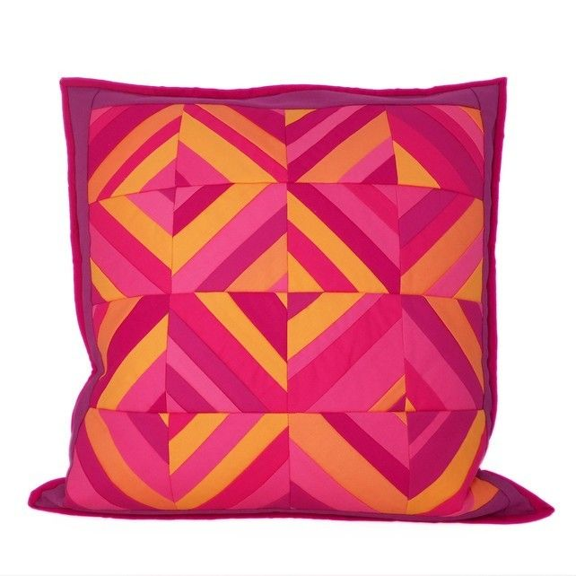 Stripes in Squares Cushion by Flamingo Tree. Hand crafted quilted cushion with vibrant pink and orange stripes, enclosed in a mulberry/plum border.
