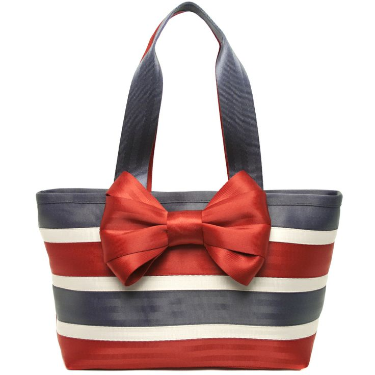 The Spangled Bow Tote is vintage-inspired and patriotic as heck! We love the big red attached bow and the side-by-side stitched, mixed-size striped of Red, Navy and Pearl seatbelts!