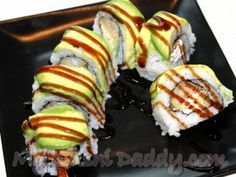 Sushi roll - Palm Beach Shrimp Tempura Roll with Avocado on Top. Need to learn to make sushi soon!