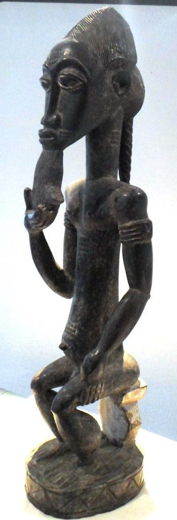 SOLD SOLD Baule Tribe Male statue sitting on a chair pulling his beard,Wood,Ivory Coast