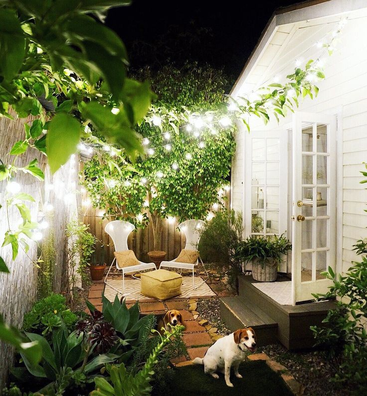 the softly glowing backyard is warm and welcoming thanks in large part to twinkle lights
