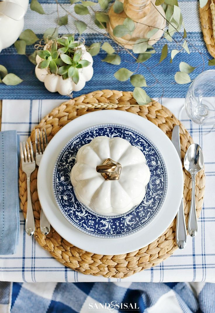 A Blue and White Thanksgiving Table is perfect setting for a relaxed and casual holiday setting. White pumpkin soup bowls add a charming touch to the table.
