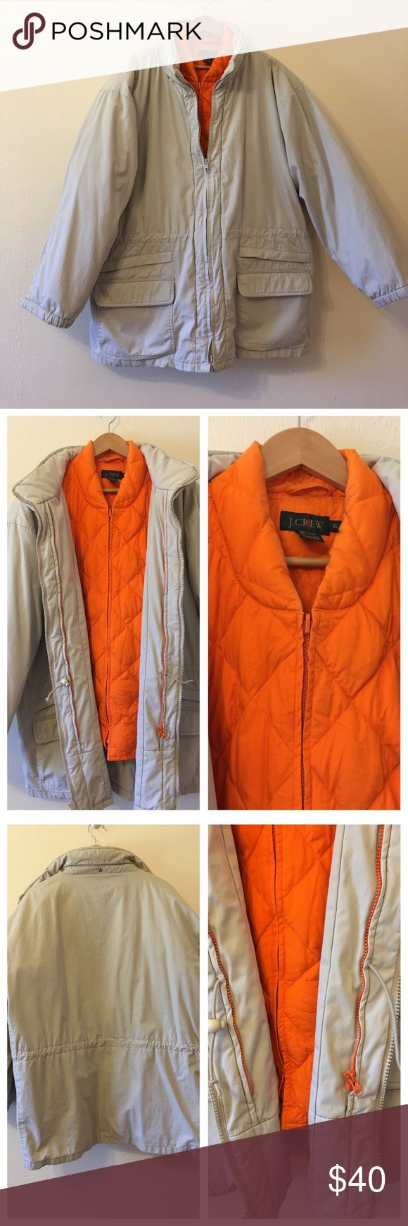 J. Crew 3-in-1 down jacket This is a jacket with a down jacket inside and a another jacket outside. The orange down jacket can also be worn as a vest. Many spacious pockets. You can zip up the orange jacket to the tan one or zip it on its own. There is a stain on the inside of the orange jacket. It cannot be seen when you are wearing it. It is in used condition but still has a lot of life left and very clean. J. Crew Jackets & Coats