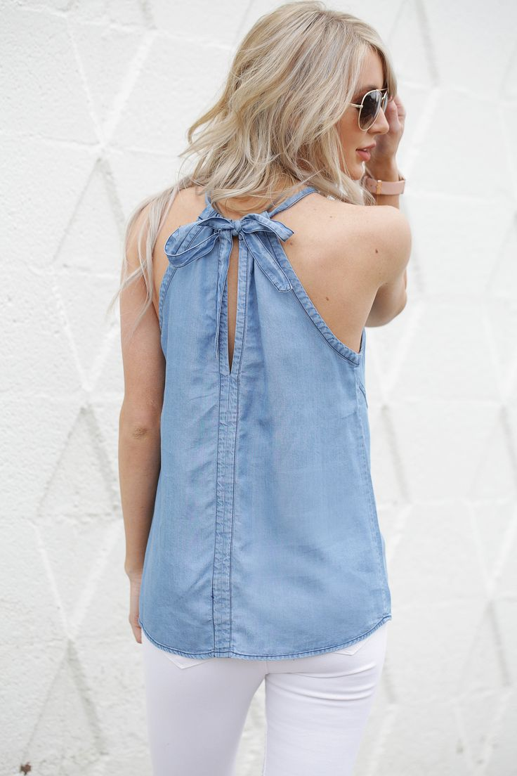 I denim dare you not to love this tank. Our Halt Right There Tank features a halter top chambray denim with a back of the neck tie, back middle seam, and two front of bodice curved seams.
