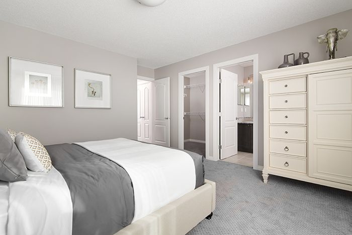 Owner's bedroom / master suite  in the Wysteria showhome in the community of Redstone in northeast Calgary