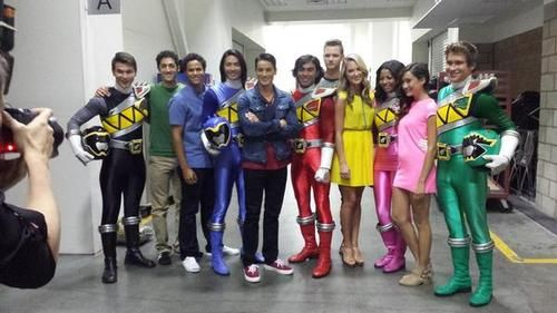 The cast of Power Ranger Super Mega Force pose with the cast of the upcoming Power Rangers Dino Charge. Notice that there is FINALLY an African-American pink ranger. (Thanks Saban!)