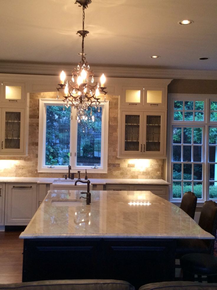 Cream colored cabinets, Taj Mahal Quartzite countertops, marble light empador backsplash, Wellborn cabinets, Rohl all the way with the sinks and faucets! Love it! The quartzite alone adds a WOW factor!