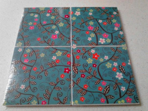 Set of 4 decoupaged tile coasters. Multi colored flowers on teal background by BlackwellsBoutique