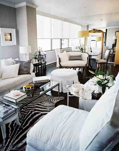 Black floors and zebra rugs get me every time. If I wasn't already in need of an animal-print intervention, I'd totally make this happen.