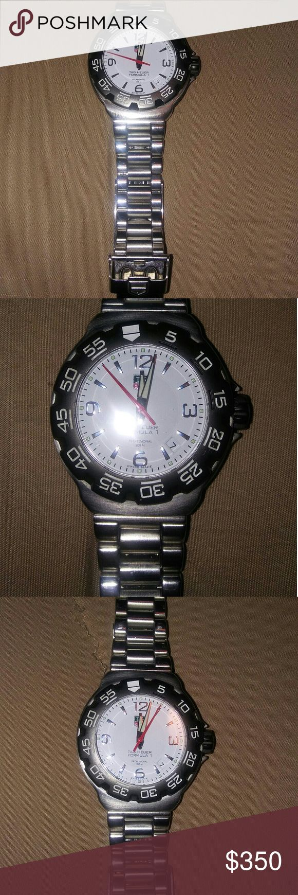 Tag Heuer Formula 1 Professional 200 Meters Watch. Tag Heuer Formula 1 Professional 200 Meters Watch. Mint Condition. New Crystal And Battery. Divers Extension. Price- $350.00. This Will Make An Amazing Christmas Gift! This goes for $450.00 Plus On Ebay So This Is An Amazing Deal. Serious Buyers Only Please! More Pictures And Videos Upon Request Will Ship Same Day Unless Post Office Is Closed For A Holiday! Tag Heuer Accessories Jewelry