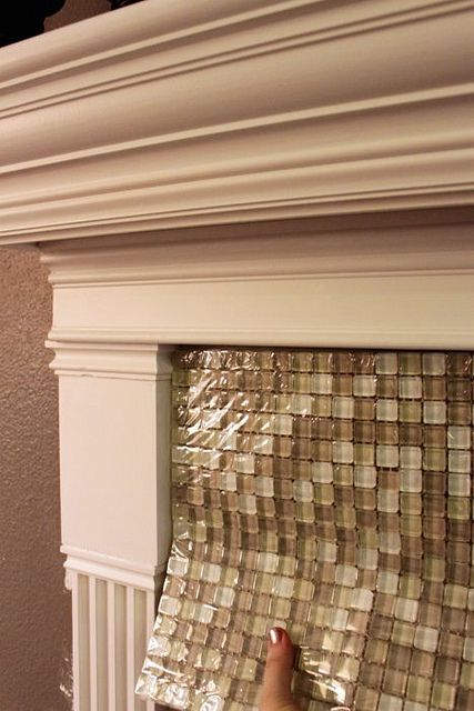 25 best ideas about glass tile fireplace on pinterest for Fireplace material options
