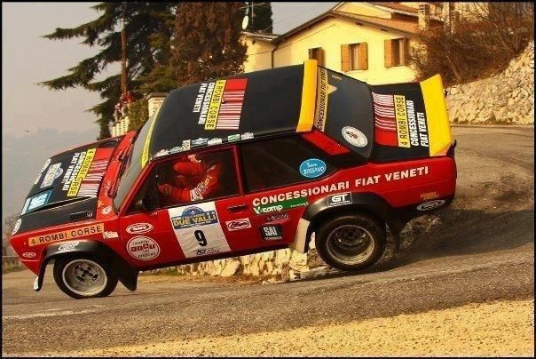 Fiat rally race car on two wheels.