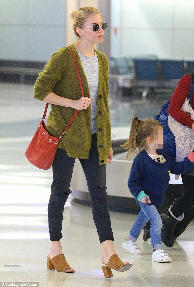 Casual: The Burnt actress was dressed down for her flight, sporting a moss green cardigan and ripped jeans