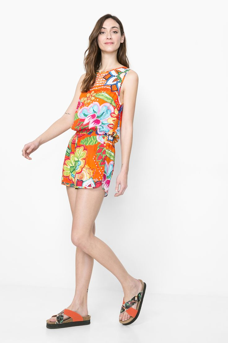 This  flowing, sleeveless playsuit has a brightly colored print and it feels as good as it looks!