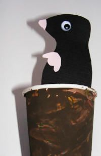 Mole in a Hole: Make a mole like in the picture, tape a large craft stick to it, and cut a slit in the bottom of the cup. Stick it in the cup and through the slit so you can make him peek out. Add grass blades to the edge to give the kids a bit more to do. Maybe even add flowers!