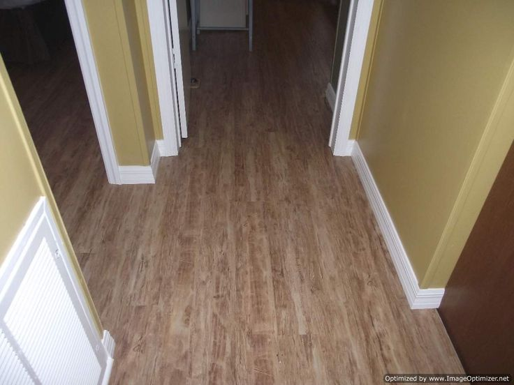 Kensington Manor Laminate Flooring Flows Into Hallway And