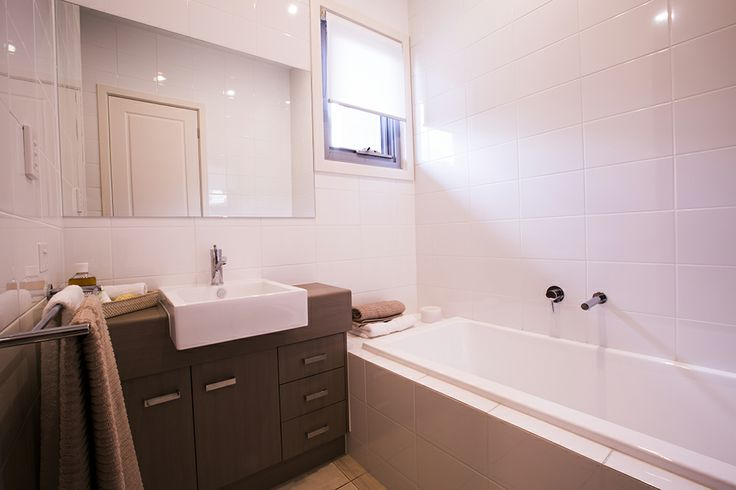 This stunning bathroom has a relaxing and luxurious feel. #bathroom #weeksbuilding #homedecor