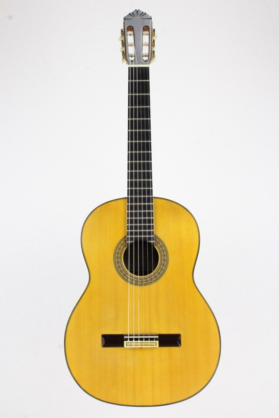 The Guitar Features A Bright And Snappy Top Often Made Of Spruce The Top Often Features A Tap Plate That Protects It Guitar Guitars For Sale Classical Guitar