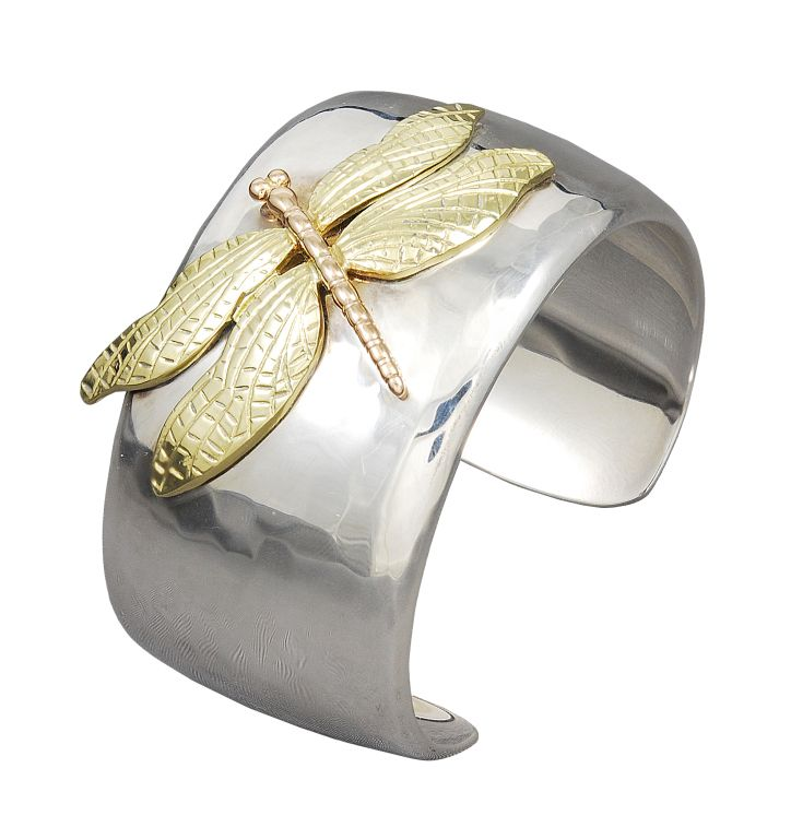 Wide hand-hammered sterling silver cuff bracelet with 18K gold figural applied dragonfly, signed Tiffany & Co.This bracelet was brought back by Tiffany in 2001 and now is no longer available. A Classic!!!