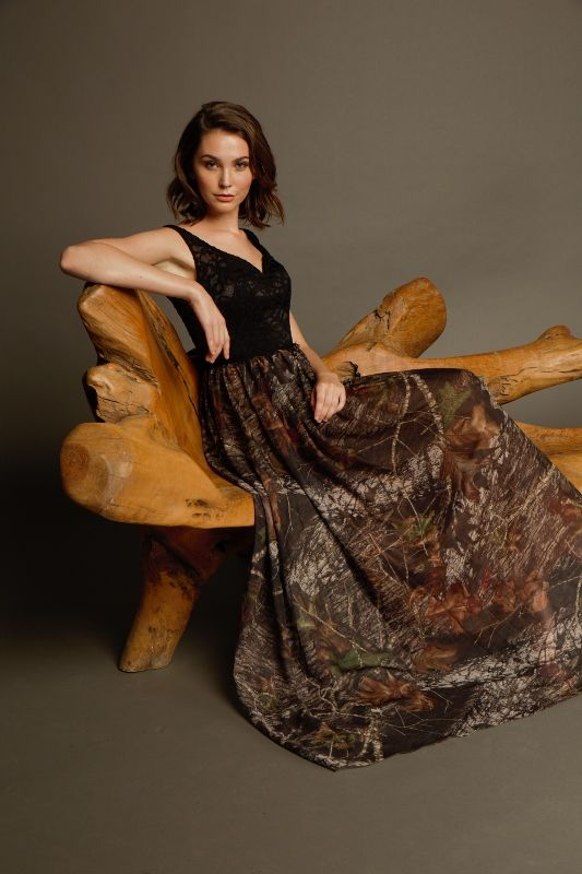 Carrafina Camo Prom and  Special Occasion Dresses. LICENSED Mossy Oak and Real Tree  This dress is amazing!  Black lave vneck Bodice with your choice of Mossy oak breakup, winter breakup or Real Tree AP Pink on the skirt!
