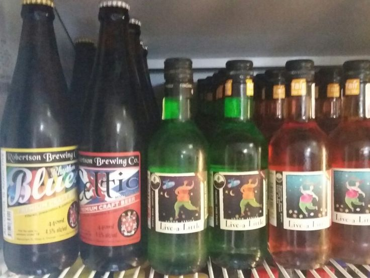 Local hand crafted beer made by the Robertson family, and Organic South African wine with the fun name Live-a-Little.