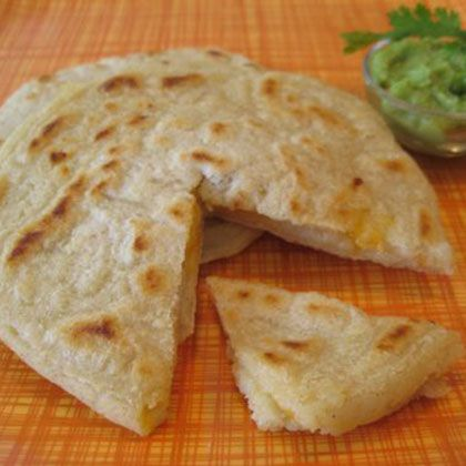 Delicious papusas--experiment with different fillings. Your kids will love these--and have fun making them with you.