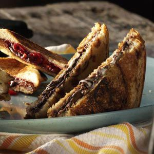 S'more Pudgy Pie-- 2 slices cinnimon bread, 2 tbs. Nutella spread, 1/2  graham cracker crumbled, 1 tbs. Mini marshmellows--spread nutella on slice of bread, sprinkle crumbs on top, add marshmellows, grill as for grilled cheese or use sandwich machine