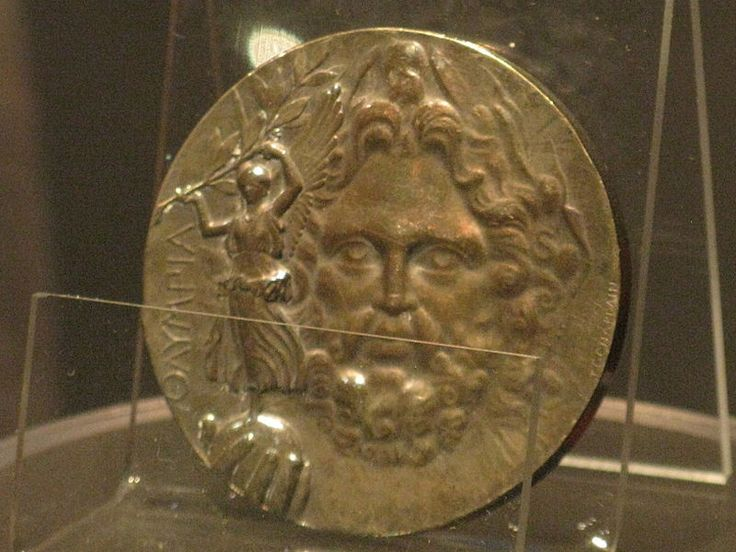 Obverse of the silver (first place) medal at a different angle, showing further detail