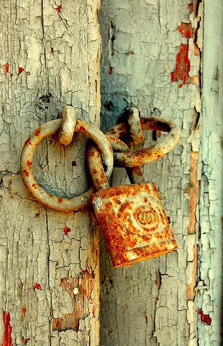 rusty lock by sophia@, via Flickr