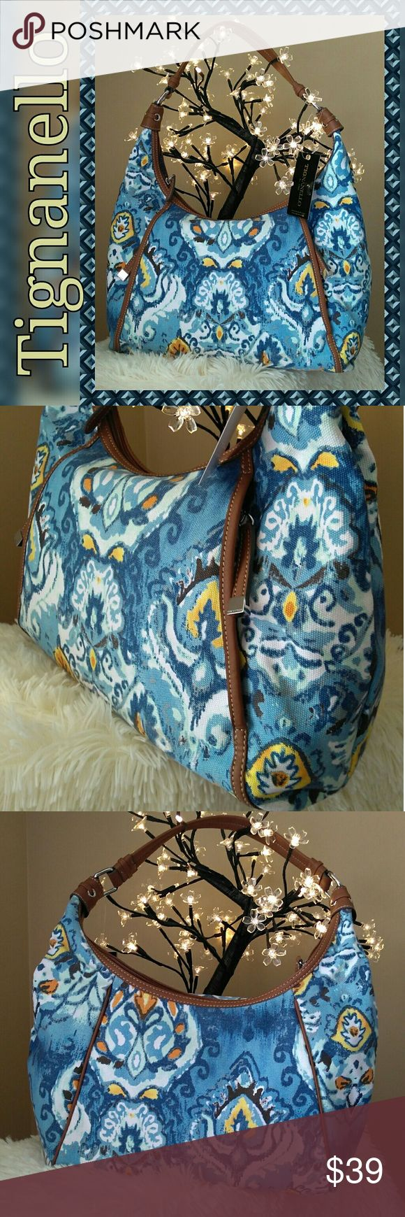 NWT Tignanello Hobo Bag Cute 100% cotton hobo bag is new with tag and original paper inserts. Has lovely vibrant colors of blue, gray, yellow, white, and highlights of mint. Trim is man made material. Interior has 2 open side pockets and 1 side zip. Exterior has 2 hidden vertical zip pockets perfect for keys or cell phone. Dimensions: 1 inches tall x 15 inches wide. Strap is 19 inches. All zips work as new. Thank you for visiting my closet 💖 Tignanello Bags Hobos