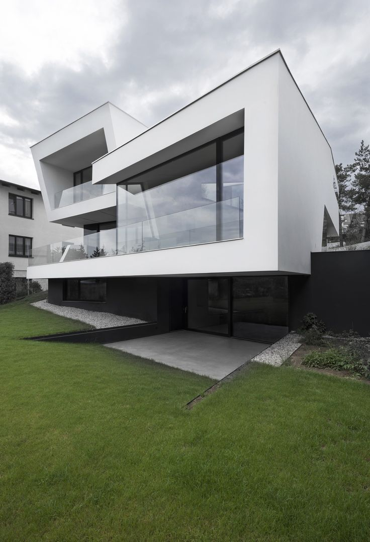 minimalist home design located on a south sloping plot in a