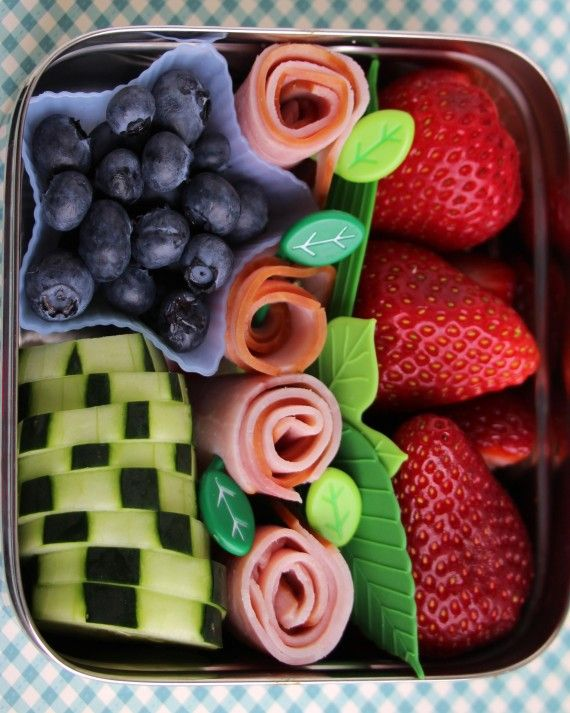 "easy enough for you to try at home! Garden-Inspired Bento""I made this lunch when the roses in my backyard were in full bloom. The ham roll-ups looked like rosebuds to me, so I added a few decorative picks with leaves on them and some silicone dividers that looked like leaves to give this lunch a garden feel."""